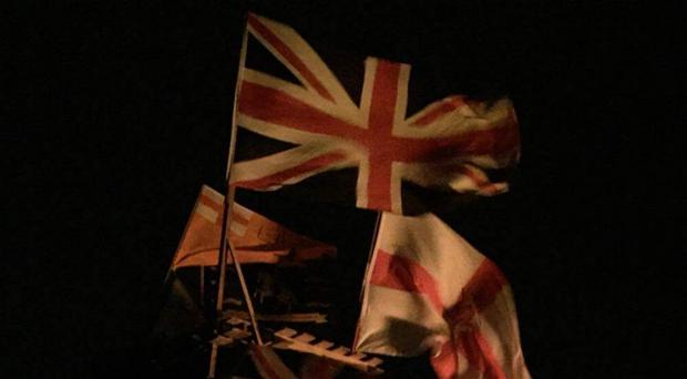 Flags on top of a Halloween bonfire in Strabane