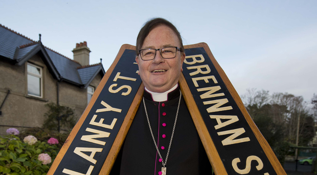 Bishop Pat Buckley with street signs he 'liberated' from the Shankill Road in Belfast