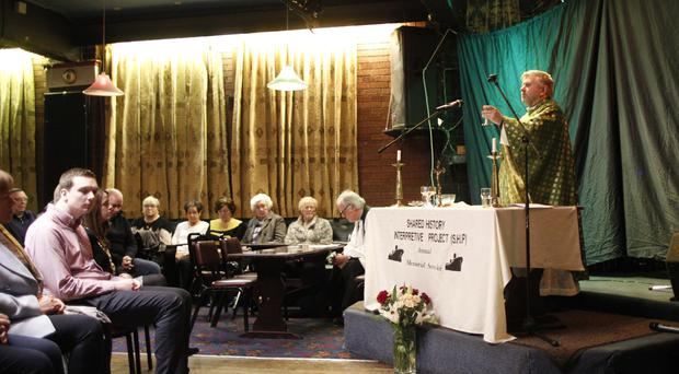Fr Gary Donegan takes Mass at the Dockers Club in Pilot Street, Belfast, in a service held to remember all those dockers who died over the years