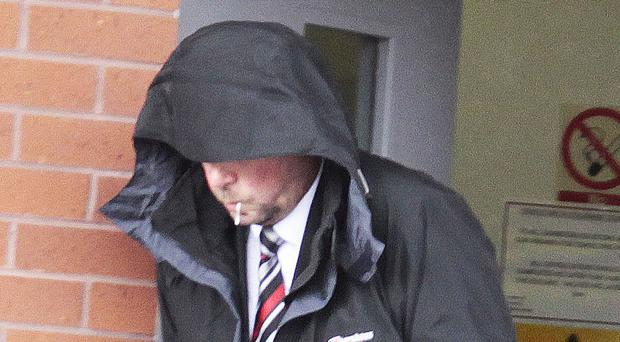 Disgraced PSNI officer Phil Adamson leaves court after an earlier hearing