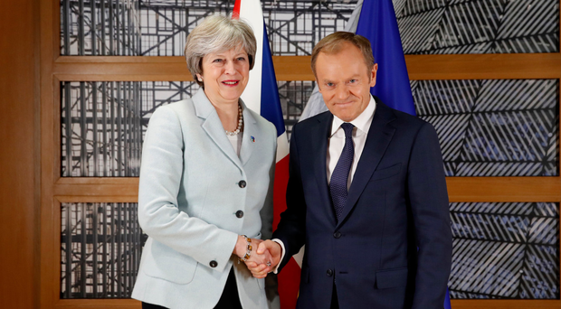 PM Theresa May shakes hands with European Council President Donald Tusk yesterday