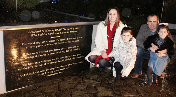 Janet Dixon, with husband James and daughters Rihanna and Clara-Jane, unveiled a new stone at the Angel of Hope Memorial Garden. Janet lost her daughter Gabrielle after 11 days and raised more than £700 for the tribute with a leap into Ballintoy Harbour