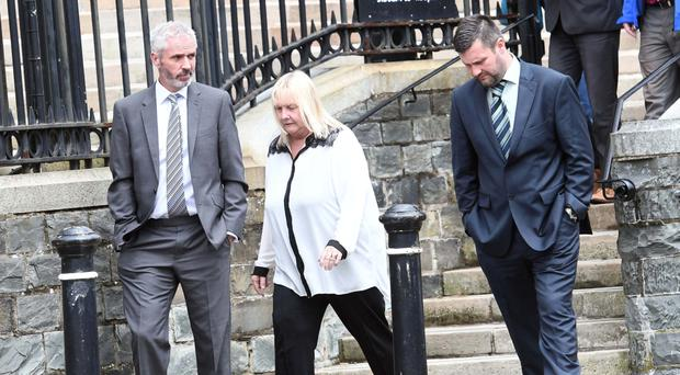 Robert White, his wife Wendy, both 56, and their 36-year-old son Paul at Downpatrick Court in Co Down