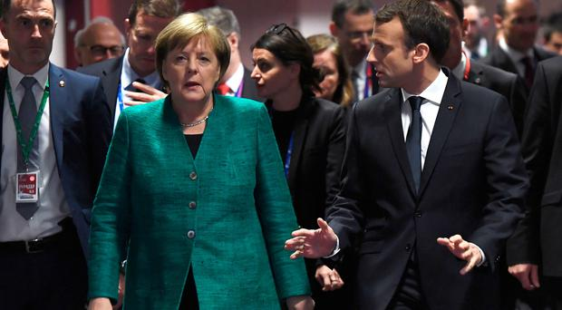 German Chancellor Angela Merkel (L) and France's President Emmanuel Macron