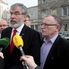 Sinn Fein president Gerry Adams with Dessie Ellis outside Leinster House