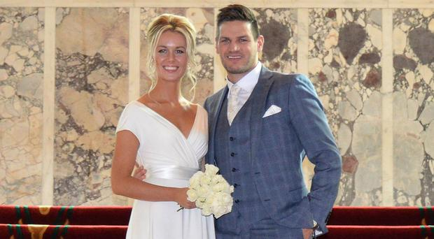 Adam Keefe and his wife Colleen at their wedding