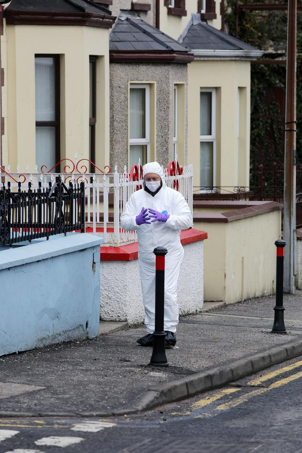 Police and forensics officers at the scene of the murder of Karol Kelly