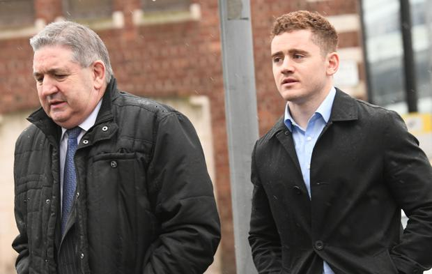 Paddy Jackson, (right), at Belfast Crown Court today where he stands accused of rape and sexual assault.