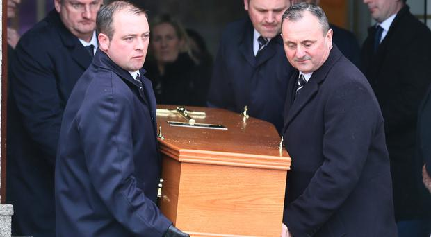 The remains of Frank Murray are carried from The Church of Our Lady of Perpetual Succour after his funeral mass in Foxrock