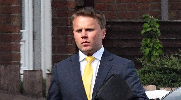 DUP councillor Thomas Hogg arrives home on foot yesterday after he was banned from driving at Belfast Magistrates' Court and fined £250 for driving with excess alcohol on April 29