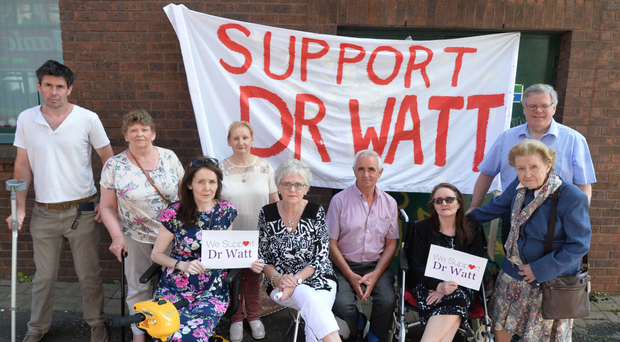 Patients and family and friends protest in support of Dr Michael Watt in Belfast yesterday