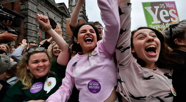 Yes campaigners react at Dublin Castle on Saturday as the official result of the referendum was announced