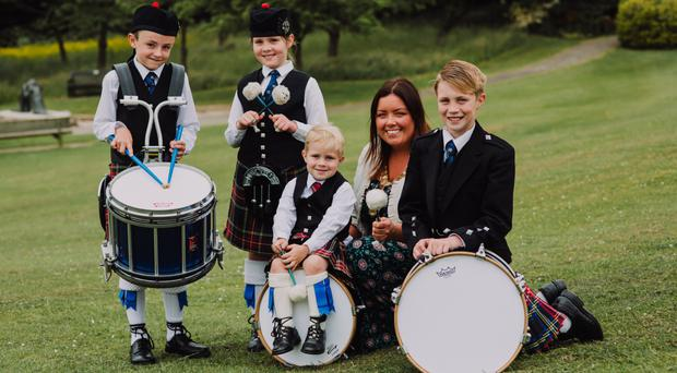 From left, Jamie Coffey, Evie McKeown, Thomas McIlwaine and Oliver McIlwaine join the new Lord Mayor of Belfast, Deirdre Hargey on her first official engagement to launch the UK Pipe Band Championships which will take place at Stormont Estate on Saturday, 16 June. For event details go to www.belfastcity.gov.uk/pipebands