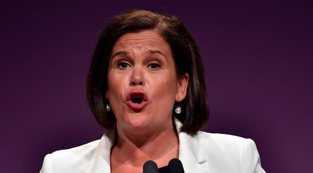 Mary Lou McDonald was centre-stage at the Waterfront Hall, while Mr Adams took his seat in the stalls beside party veteran Tom Hartley