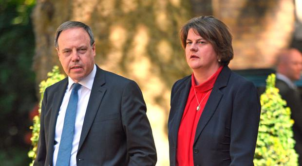 DUP leader Arlene Foster and deputy Nigel Dodds arrive in Downing Street yesterday