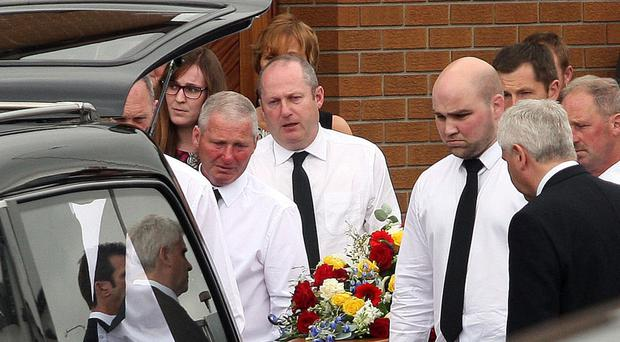 Family and friends at the funeral of Philip Capper, who died in traffic accident
