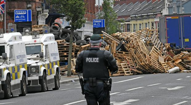 Toppled tower: the Cluan Place bonfire was knocked down on safety grounds