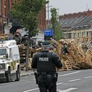 Toppled tower: the scene at the Cluan Place bonfire earlier this month