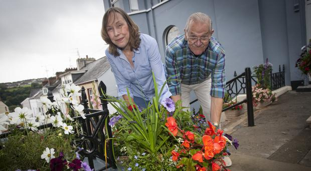 Terraced garden: Jim and Maureen Nelis pictured outside their Abercorn Terrace home in Londonderry