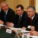 Richard Bullick (centre) with Martin McGuinness and Peter Robinson