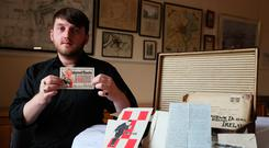 Aaron McIntyre holds a Ludendorff Fund for Disabled Ex-Servicemen receipt