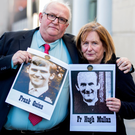 Pat Quinn with an image of his brother Frank and Geraldine McGrattan with an image of her uncle Fr Hugh McMullan, who were both killed by the Army in 1971