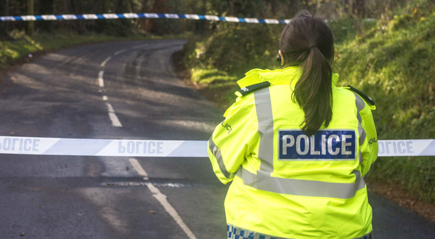 Police at the scene of the fatal crash, which happened on theGlenshesk Road between Ballycastle and Armoy