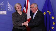 Theresa May is greeted by European Commission President Jean-Claude Juncker in Brussels yesterday