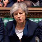 Prime Minister Theresa May reacts after the historic defeat