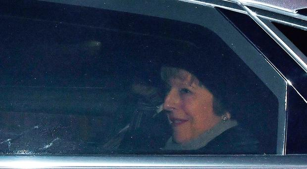 Mrs May leaves the Houses of Parliament