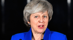 Prime Minister Theresa May speaks outside Downing Street after MPs rejected Labour's motion of no confidence