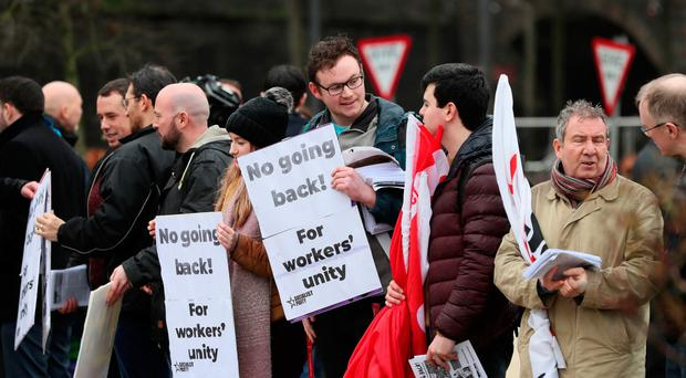 People attend the trade union-organised rally in the Peace Garden in Londonderry