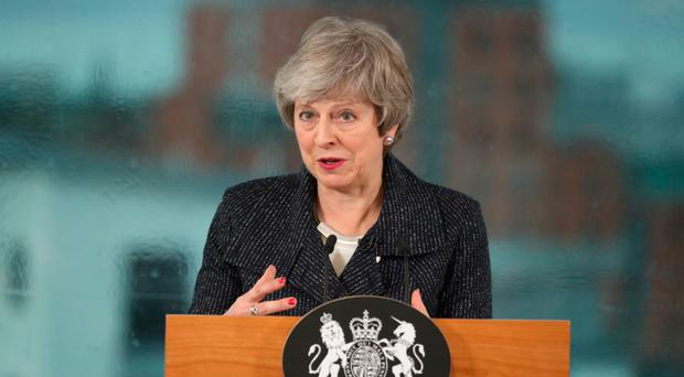 Theresa May speaks to business leaders in Belfast yesterday