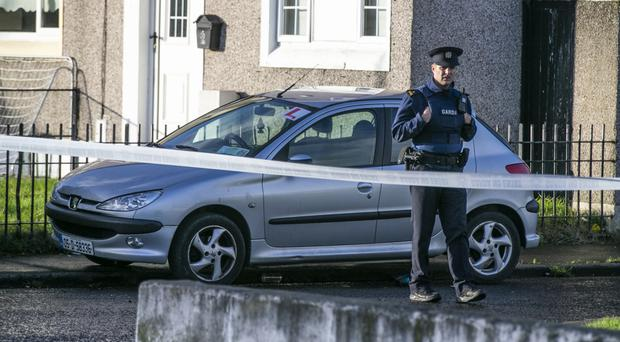 A Garda officer at the scene of the shooting of John Lawless, who later died in hospital