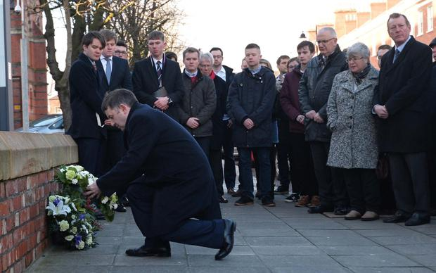 UUP leader Robin Swann lays a wreath outside Queen's University on the 35th anniversary last December of the murder of Edgar Graham