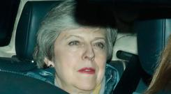 Theresa May leaves after her deal was defeated