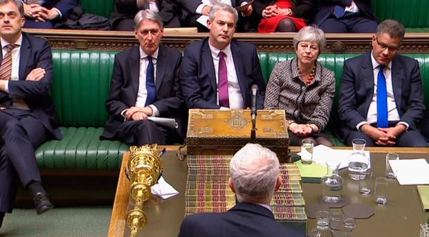 Theresa May and her party colleagues at the Commons yesterday