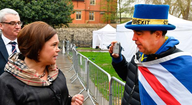 Sinn Fein President Mary Lou McDonald speaks to pro-EU protester Steve Bray in London, ahead of a meeting with Labour Party leader Jeremy Corbyn