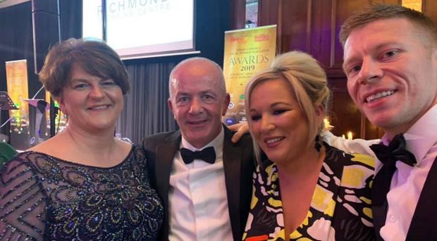 Arlene Foster and Michelle O'Neill with Stephen Garrett Snr and Stephen Garrett Jnr at the Firmus Energy Local Women Magazine Awards