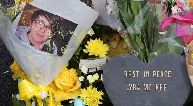Tributes left at the scene where Lyra McKee was murdered in the Creggan estate in Derry