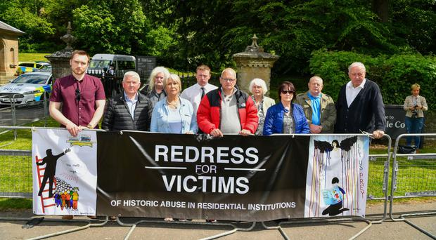 Members and supporters of the Redress For Victims group protest outside the Royal Garden Party at Castle Coole, Co Fermanagh, yesterday