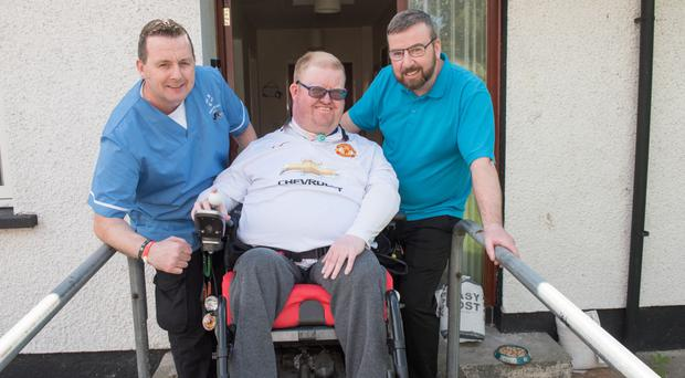Alan Saunders from Londonderry with carers Eamonn Doherty and Raymond McKenna