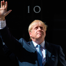 New Prime Minister Boris Johnson waves on the steps of 10 Downing Street after meeting the Queen yesterday