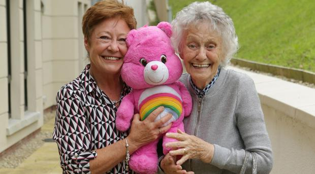 Romaine Duffin with mother Robena McAuley and Nell the bear at care home Glenabbey Manor in Glengormley, Belfast