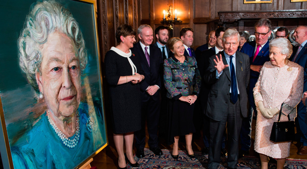 The Queen attends the unveiling of a portrait by Colin Davidson as Arlene Foster and Martin McGuinness look on