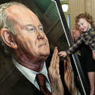 Martin McGuinness' son Fiachra and grandson Dualta at the unveiling of a portrait of his father in the Great Hall at Stormont last year