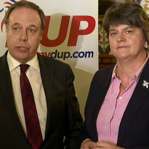 DUP's Nigel Dodds and Arlene Foster react after news of the deal PA