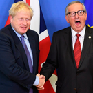 Prime Minister Boris Johnson and Jean-Claude Juncker, president of the European Commission, at EU headquarters in Brussels yesterday