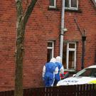 Forensic experts at the house in Bangor where a man's body was found