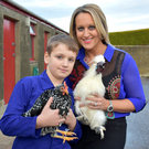Joshua Garrett and his mum Emma with some of his prizewinning birds